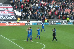 AFC Dons players applaud their following.