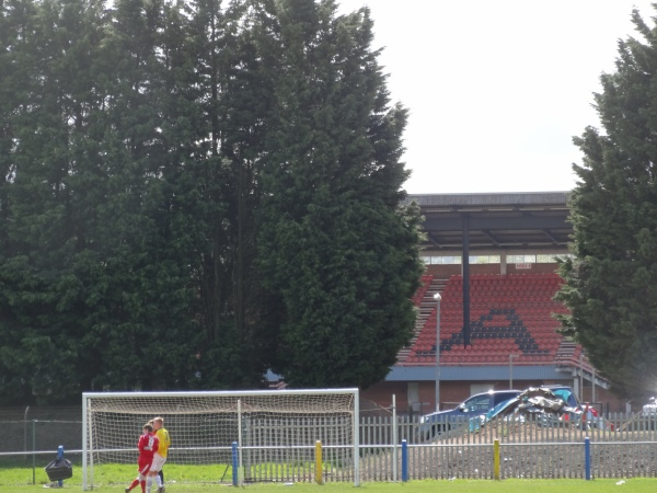 Cwmbran stadium peaking through the trees.